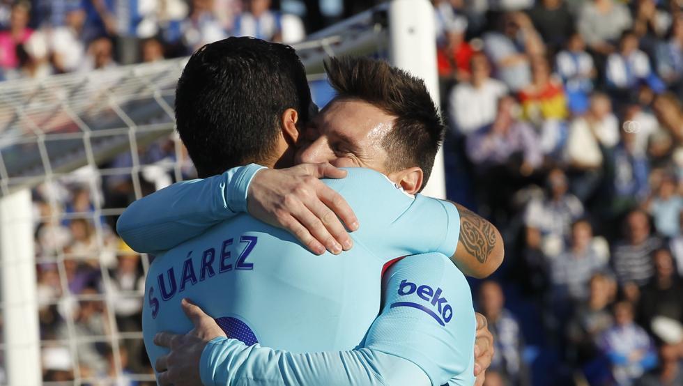 Luis Suárez con Messi
